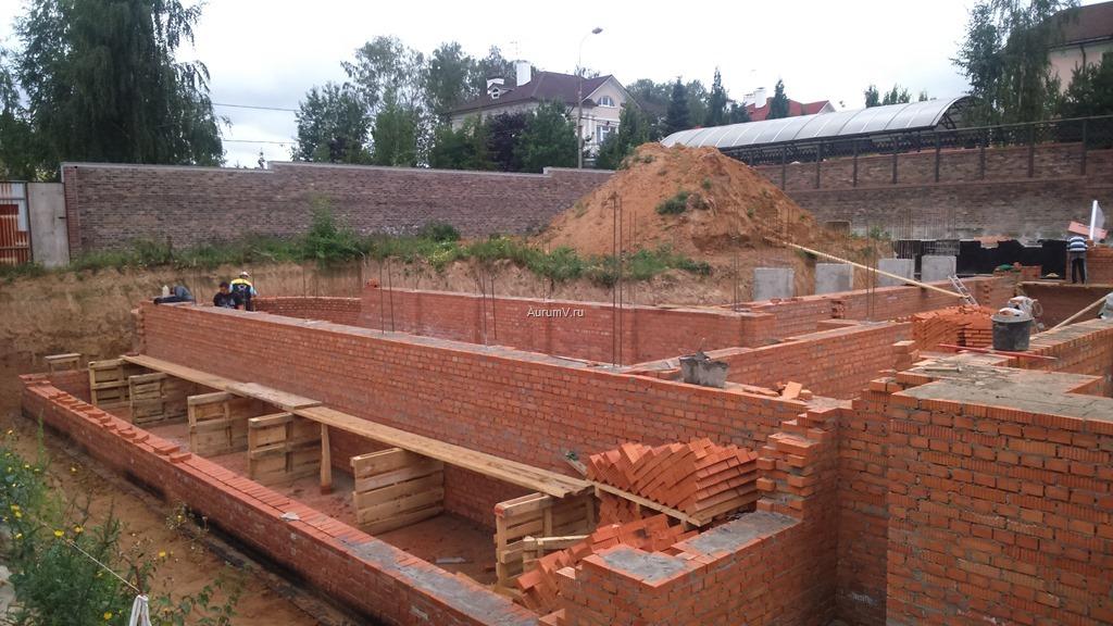 Процесс строительства кирпичного дома фото