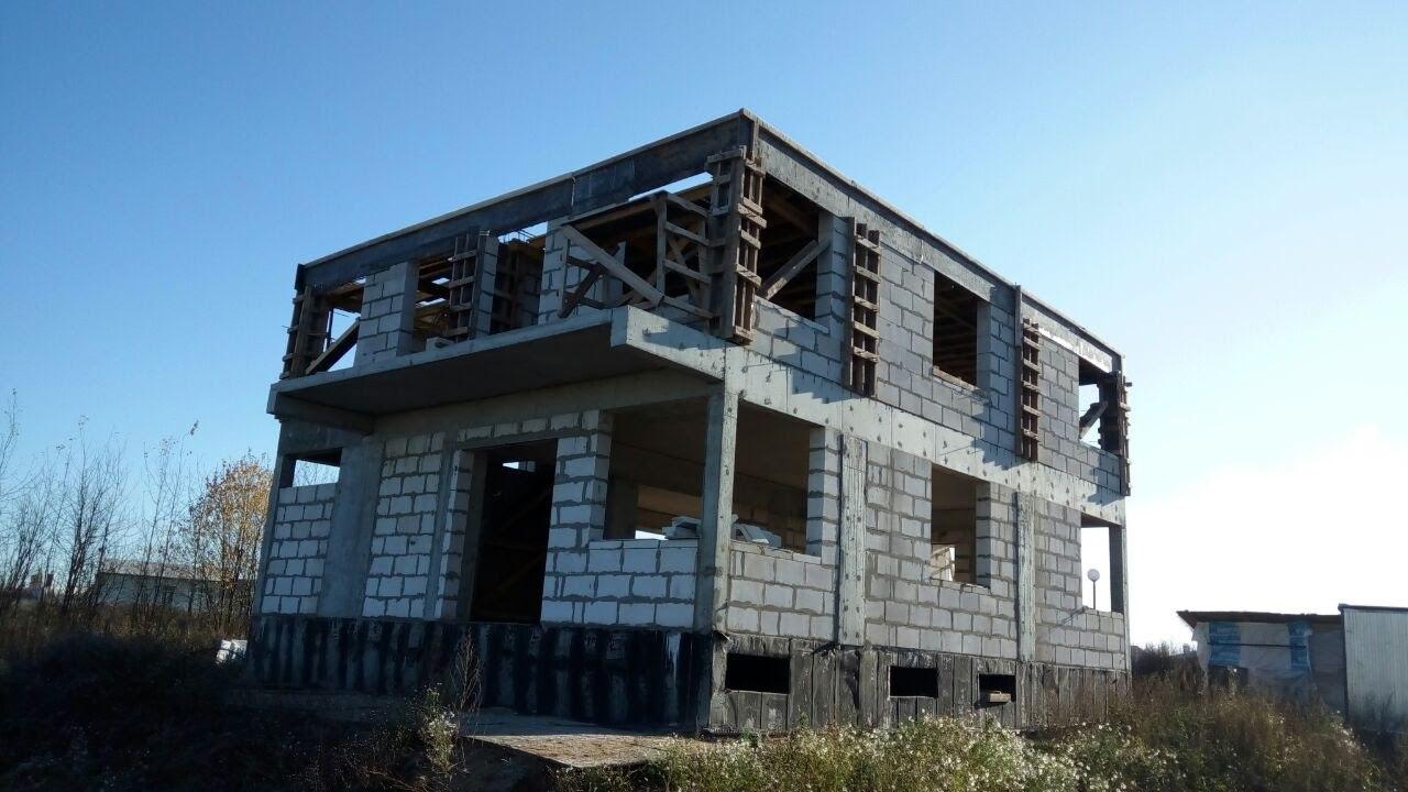 Монолитный каркас дома заполненный газобетоном